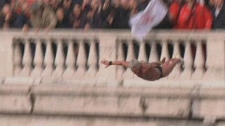 Extreme diving from bridge over Rome's Tiber river on New Year's Day