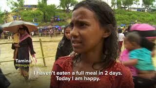 字幕付きバングラデシュの人々からロヒンギャ難民へ手渡される支援