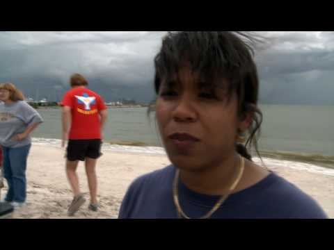 Tom McPhee interviews Dr. Delphine Vanderpool about dead Dolphin on Pass Christian Beach