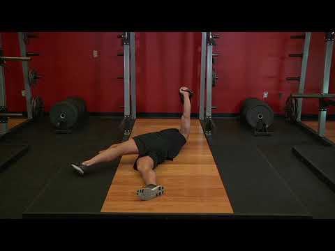 Leg Over Floor Press   Exercise Videos & Guides   Bodybuilding com