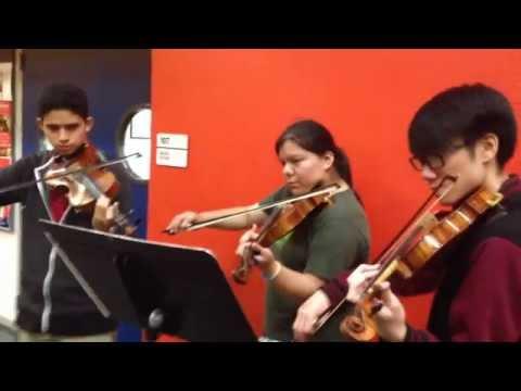 Coaching chamber music in school outreach program