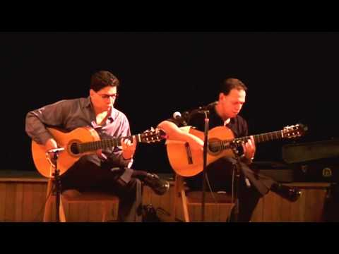 Duet rendition of a traditional folk Spanish composition, manifesting some techniques used in Flamenco guitar playing.