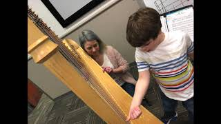 Rolph Literacy Academy teacher shares 'super power' of harp playing
