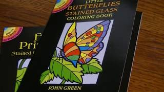 Flips Of Some Dover Stained Glass Mini Coloring Books