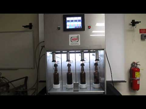 "HDP / MacDonald Steel Limited Deluxe Filler & Crowner with 8"" color touch screen. New and improved interface with easy setup and enhanced fill heads. - DFC4 Filler/Crowner - sold by HDP Brewing Systems"