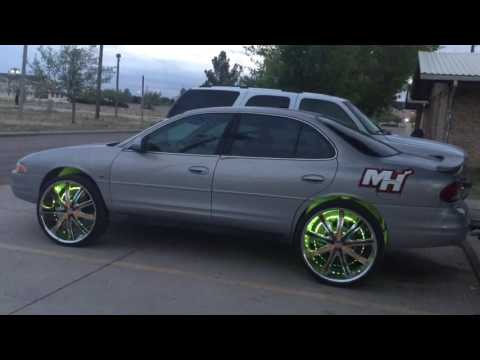 "Dream color led wheel rings on 1999 Oldsmobile intrigue on 24"" Decenti's.One side Miami Heat the ot"