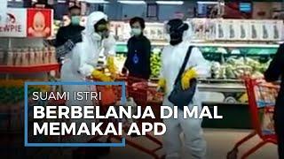 Video Sepasang Suami Istri Menggunakan APD saat Berbelanja di Sebuah Swalayan