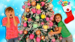 Alika and Max Decorating the Christmas Tree by Globiki