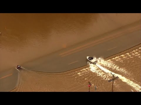 Heavy rain brought more flooding to areas of Oregon on Wednesday. Aerial video from TV Station KATU in Portland shows a boat speed over a flooded highway in Corvallis. More than 4 inches of rain have fallen in Eugene since Thursday. (April 11)