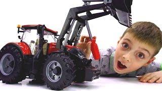 Скорая помощь и трактор в мастерской машинок Брудер (Bruder)