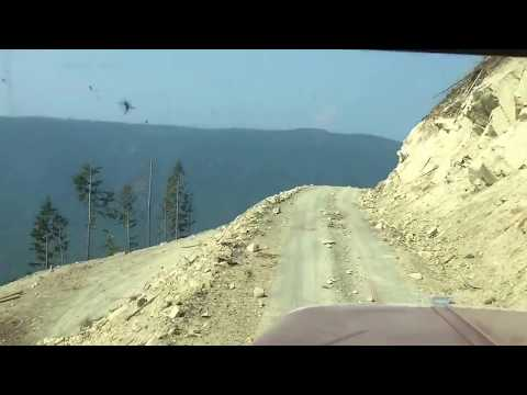 Peterbilt logging truck coming off cliff with load in Bellingham,Wa.