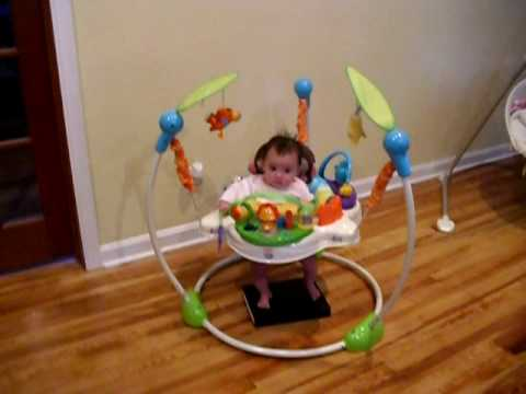 Lillyana playing in her Jumperoo