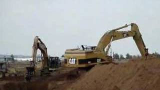 CAT 365C L & 345B L back filling & compacting