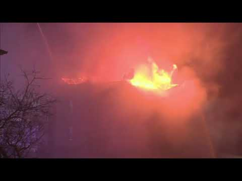A fire in a Fall River, Massachusetts apartment building has started up again, after authorities said it had been put out. The fire began when a 72-year-old woman crashed her car into the building. She died. (Jan. 2)