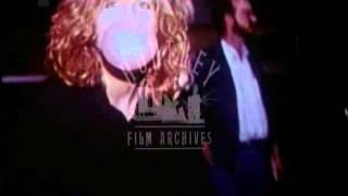 Woman blowing bubblegum.  Archive film 93056