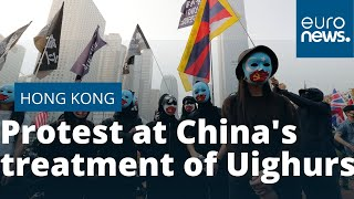 Hong Kong protest at China's treatment of Uighurs ends in violent clashes