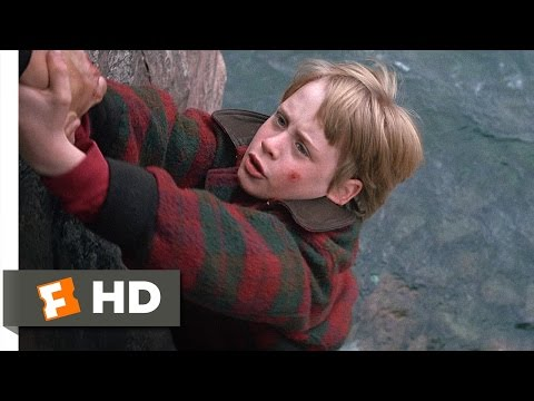 Elijah Wood and Macaulay Culkin fight to the death as children on the edge of a cliff.
