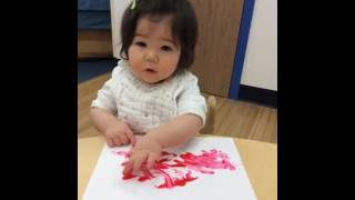 Infant Finger Painting At Apple Montessori
