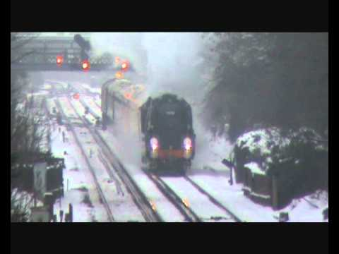With a blanked of snow on the ground, 35028 'Clan Line' depa…