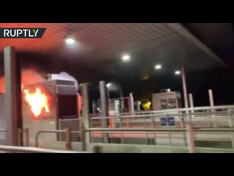 Fuel protests continue in France: 'Yellow vests' set toll booths on fire