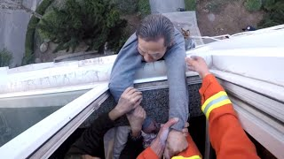 Firefighter Saves Man From Falling Out Window