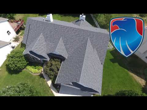 Last years hail storm didn't spare this St. Charles MO home owners roof and gutters from being totalled. The hail damage was severe in the area. If you haven't had a qualified roofing company like Freedom inspect your roof call us today!