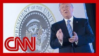 Aide fired after Trump appears with doctored presidential seal