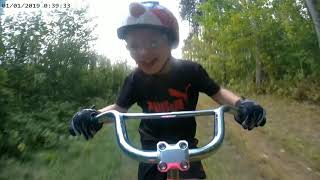 My 4 year old has started riding the singletrack with me at the reforestation camp on his tagalong.  This might be from the doubletrack section but as you can see, he loves it!  Whether it's just you or with your kids, get out and ride;)