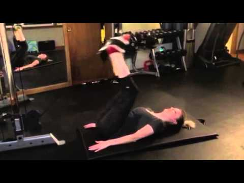 Lying cable leg raise STACK FITNESS