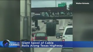 Giant Spool Of Cable Rolls Along Texas Highway