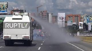 Venezuela: Molotov cocktails fly in Caracas as police hit protesters with water cannon