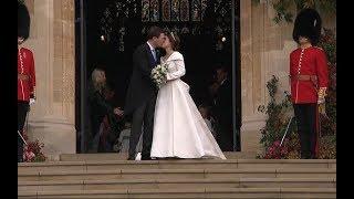 Princess Eugenie and Jack Brooksbank kiss on steps of St George