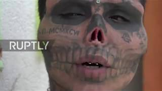 Skull-eton! Man CUT OFF nose and ears, tattooed face to resemble skull