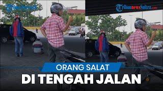 Viral Video Orang Salat di Tengah Jalan, Para Pengendara Motor Mengatur Lalulintas