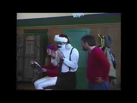 Dennis and partner Kitty performing story theatre for Christmas at an elementary school.