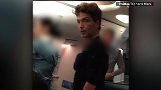 Singer restrains unruly plane passenger
