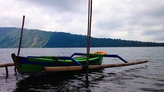 Jukung Traditional Paddle Canoe And Beratan Lake Water Scenery At Bedugul Bali