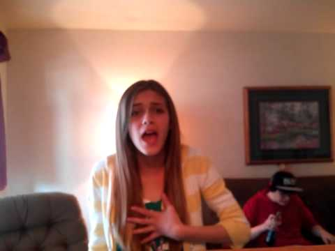 Girl singing and brother video bombs her.