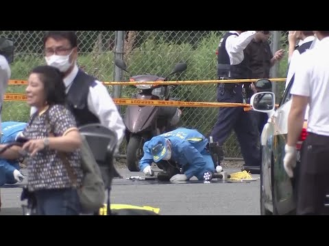 A man carrying a knife in each hand attacked a group of schoolgirls waiting at a bus stop just outside Tokyo, killing two and injuring 16. (May 28)