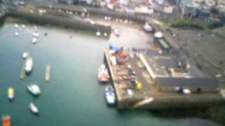 preview picture of video 'Art-Tech P51 with Flycam Over St Peter Port Harbour Xmas 08'