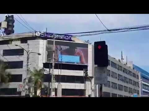 Passing drivers in hysterics as porn clip accidentally broadcast on huge billboard screen in busy ci