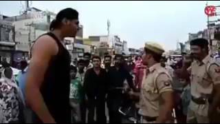 Indian common man beats Indian police... Epic fight scene on streets..