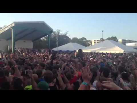 Girls crowd surfing during cypress hill