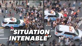 Manifestations pour George Flyod: À New York, une voiture de police fonce dans une foule
