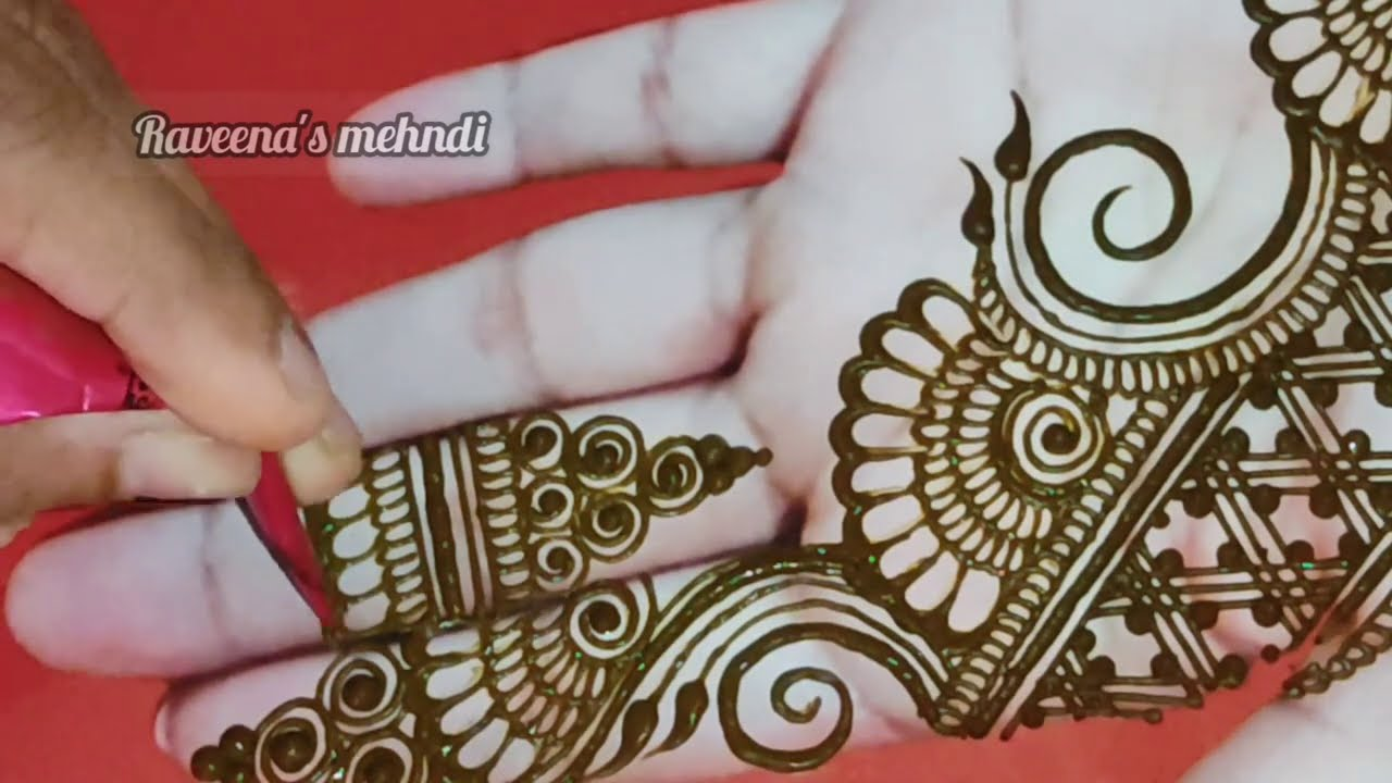 stylish bridal mehndi design for front hand by raveena mehndi