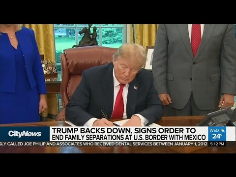 Trump signs order to end family separations at border