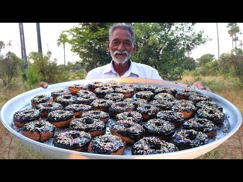 Old indian Grandpa makes donuts near his village, feeds them to children