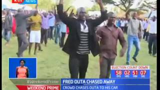 Nyando MP Fred Outa is forced to fire in the air to save himself from a re-surging crowd