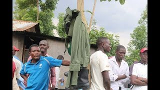 County officials dig up body to get uniform - VIDEO