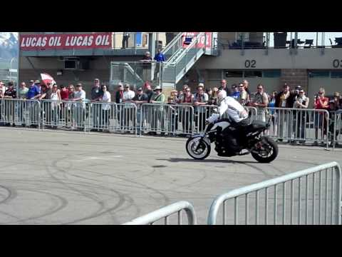 Super car video The bmw motorcycle stunt team put on a show at..